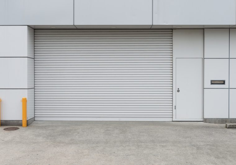 A closeup shot of automatic metal roller door used in factory, s